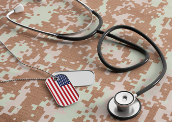 Stethoscope and dog tags on military camouflage
